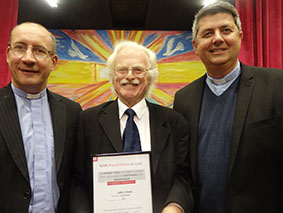 Jeff Coleman receiving his long-service LP certificate with the Superintendent Howard Long and the Synod Chair.